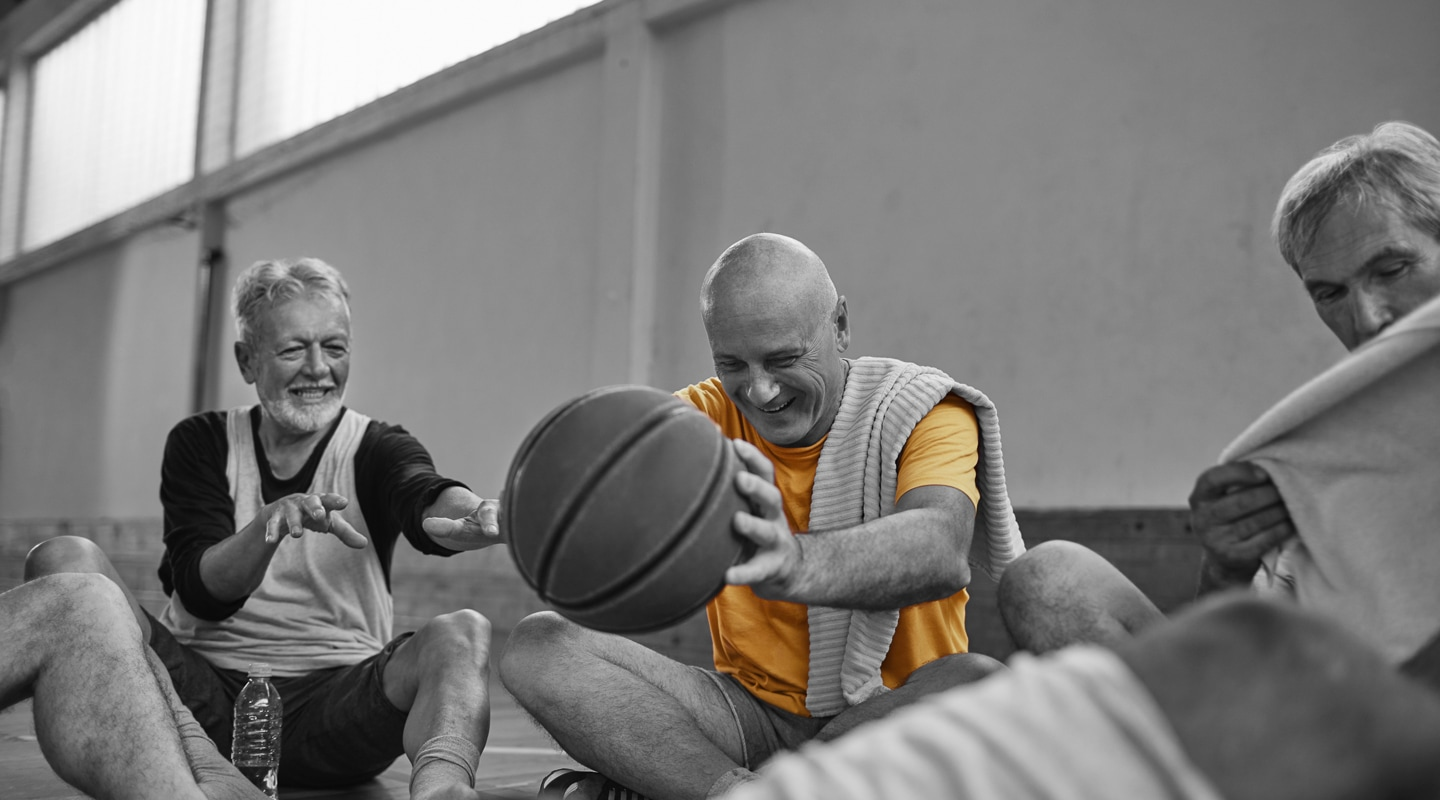 Retiree basketball team take a break from the game to enjoy a chat and a laugh
